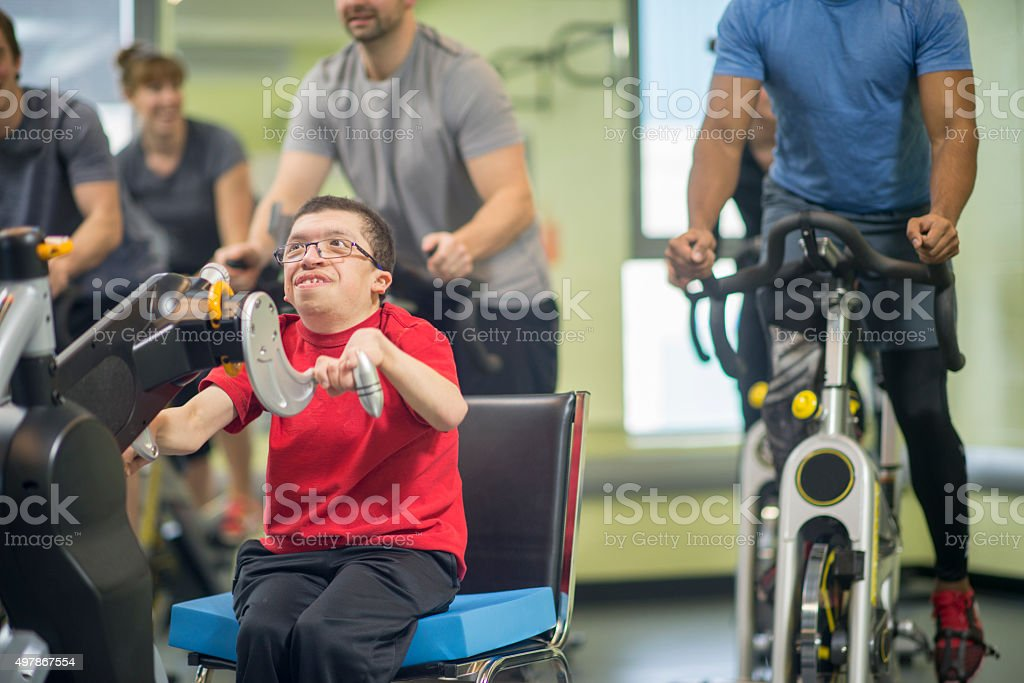 Disabled Man in a Cycling Class stock photo
