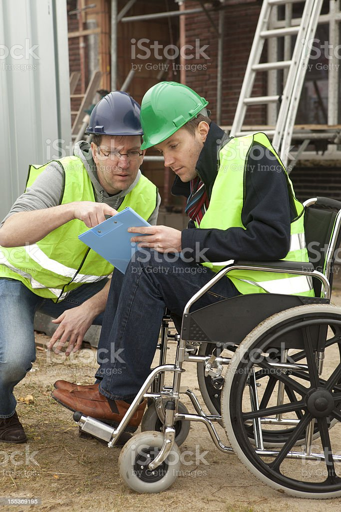 Disabled man in wheelchair collaborate stock photo