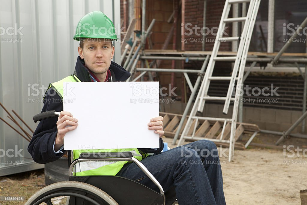 Disabled man in wheelchair holding billboard stock photo