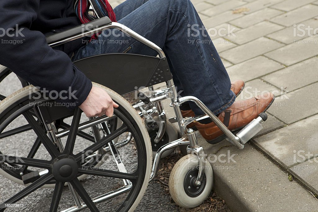 Disabled man in wheelchair needs help, fatality stock photo