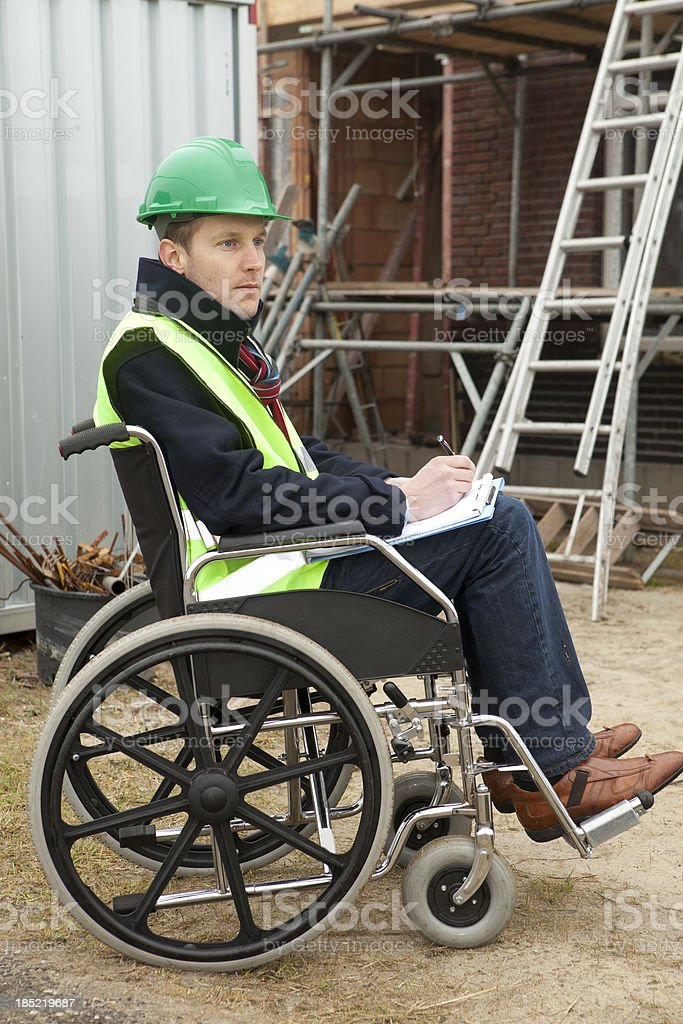 Disabled man in wheelchair working stock photo