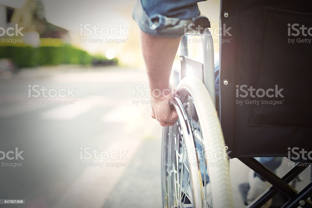 Disabled man on a wheelchair stock photo