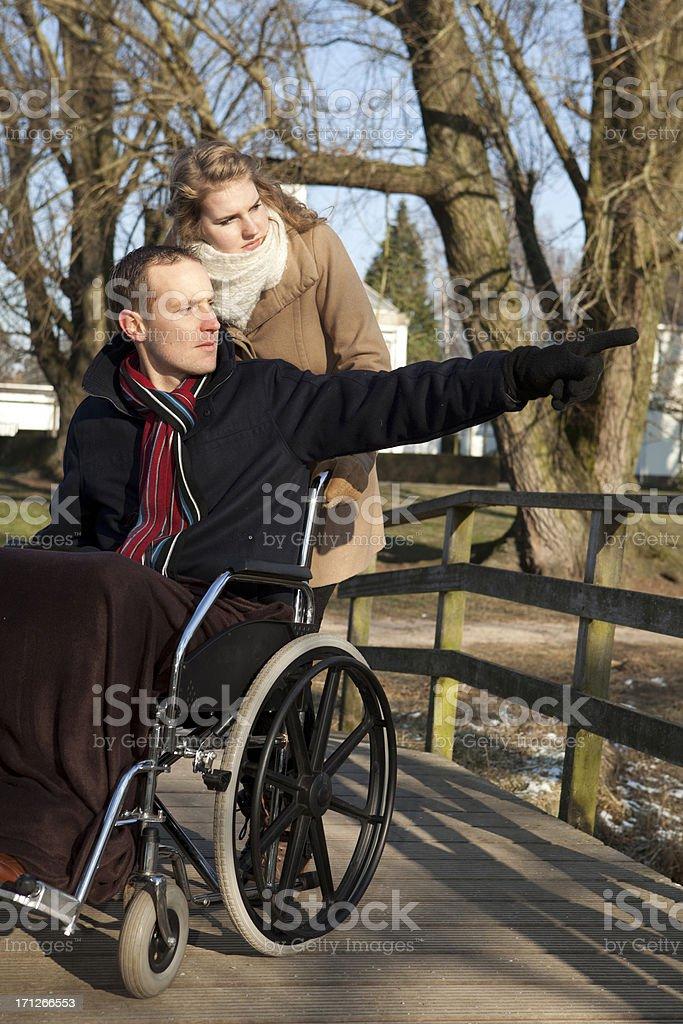 Disabled Man Pointing Towards Something stock photo