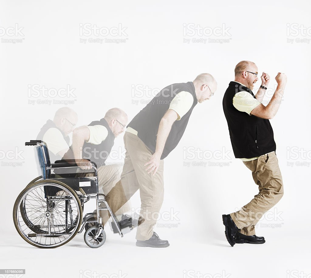 Disabled man rises from wheelchair, delighted, in composite multiple shot stock photo