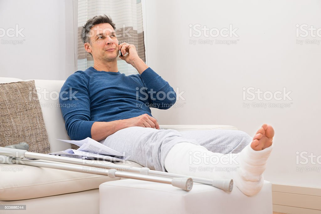Disabled Man Talking On Cellphone stock photo