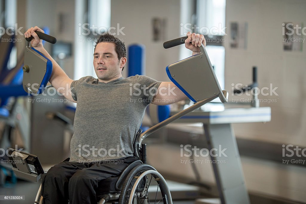 Disabled man Training at the Gym stock photo
