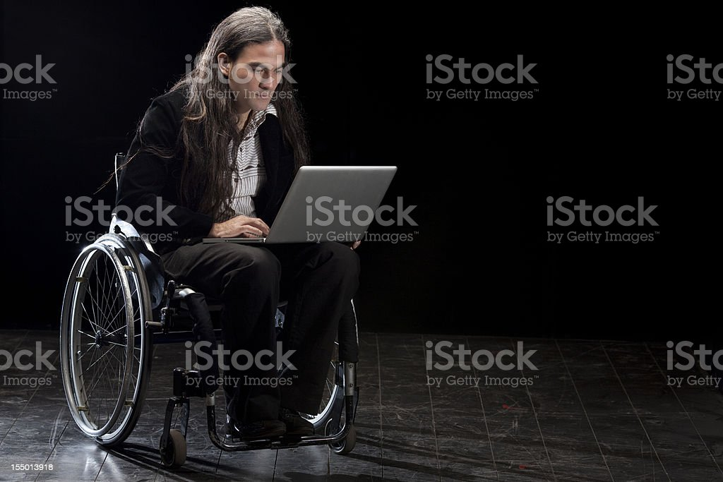 Disabled man using laptop royalty-free stock photo