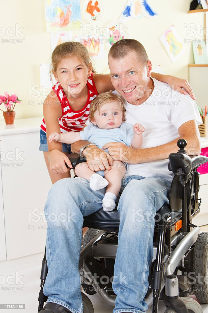 Disabled man with children stock photo