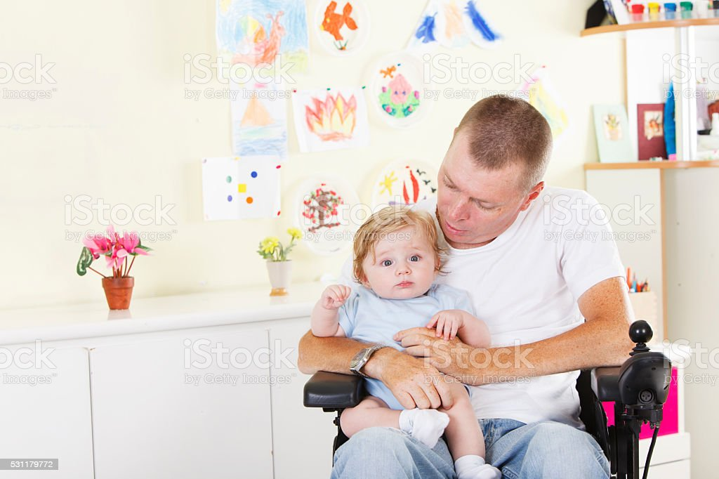 Disabled man with his son stock photo