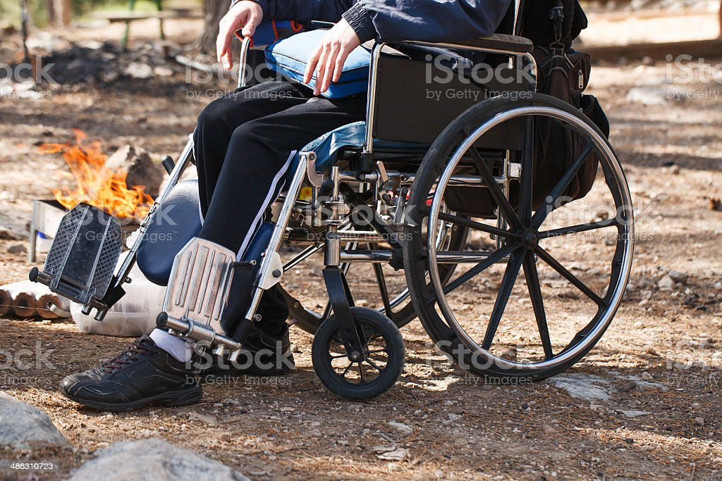 Disabled men near the fire. stock photo