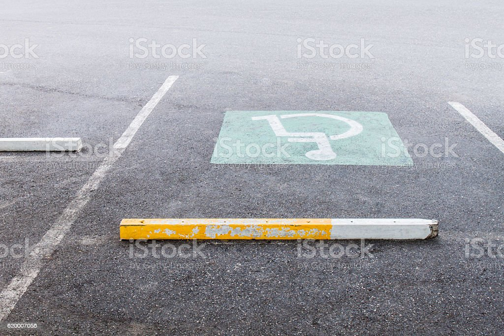 disabled on parking lot stock photo