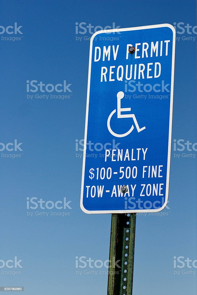 Disabled Permit Required Sign, wheelchair, Penalty, Close-up stock photo