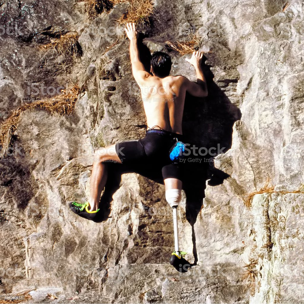 Disabled Rock climber stock photo