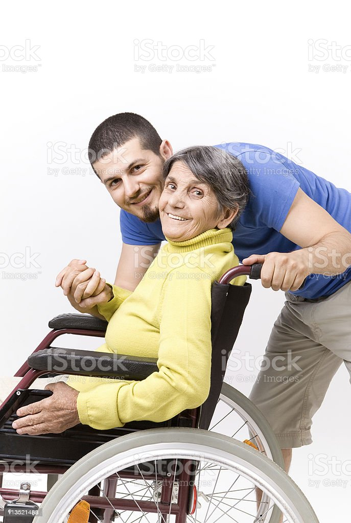 Disabled senior with his son royalty-free stock photo