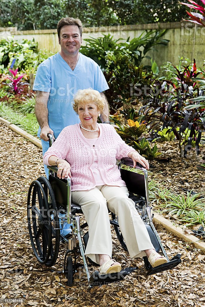 Disabled Senior Woman and Nurse royalty-free stock photo