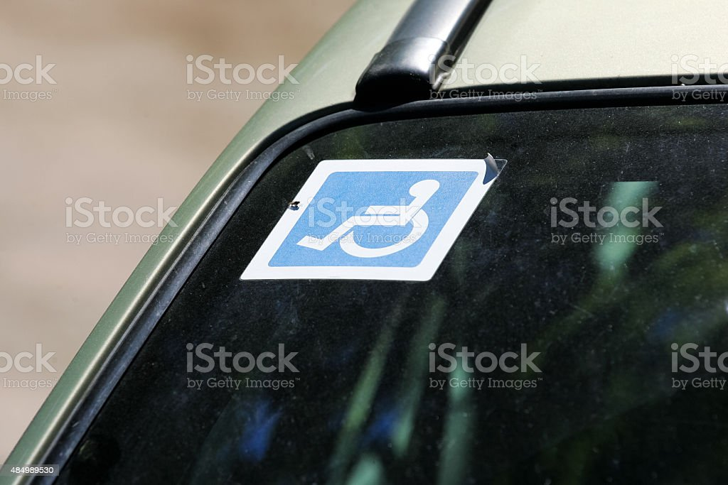 Disabled sign on the car glass stock photo