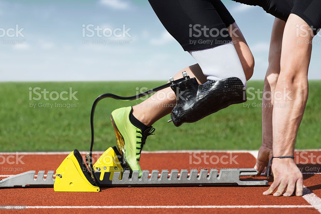 disabled sprinter start block stock photo