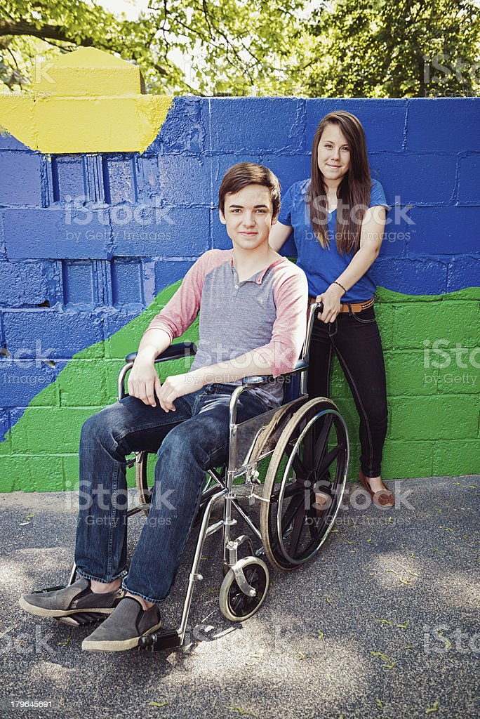 Disabled teen with Girlfriend royalty-free stock photo