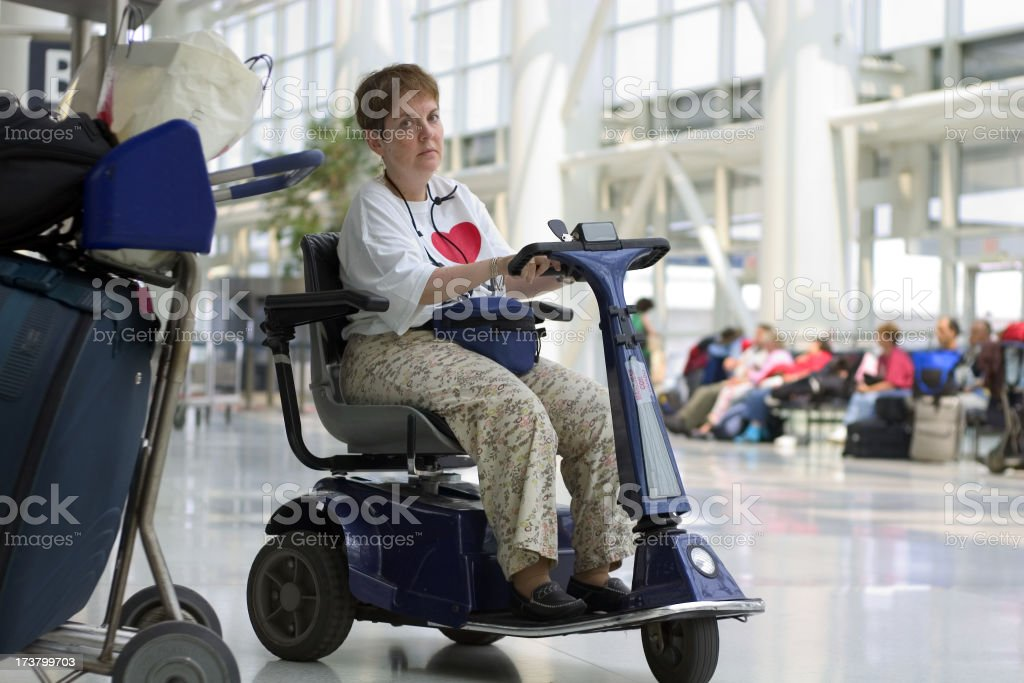disabled waiting at a check-in line stock photo