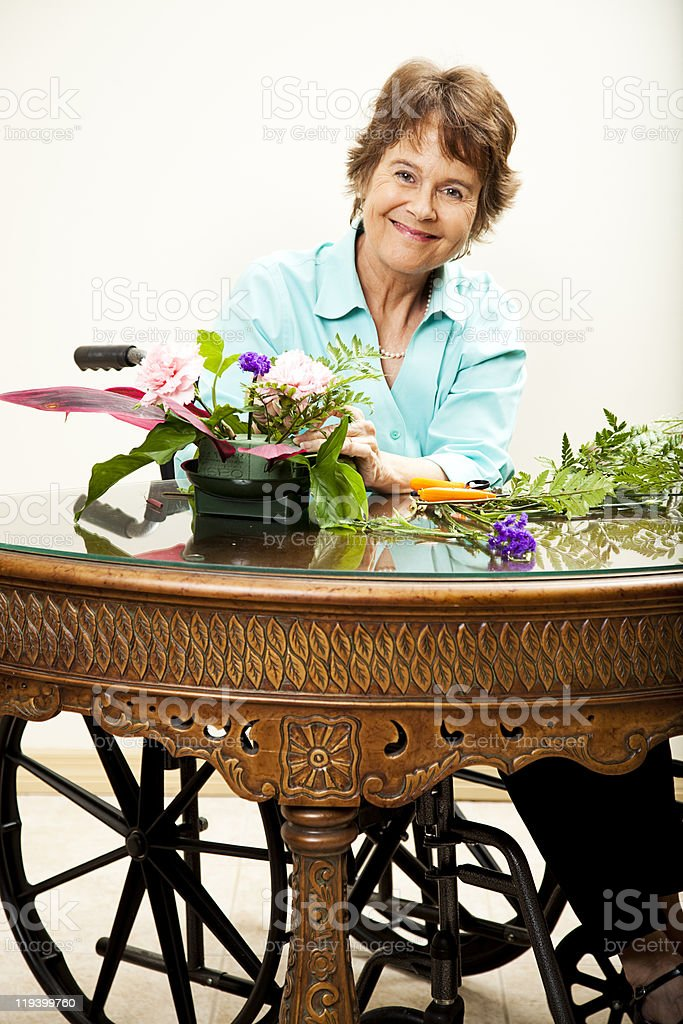Disabled Woman Arranging Flowers royalty-free stock photo
