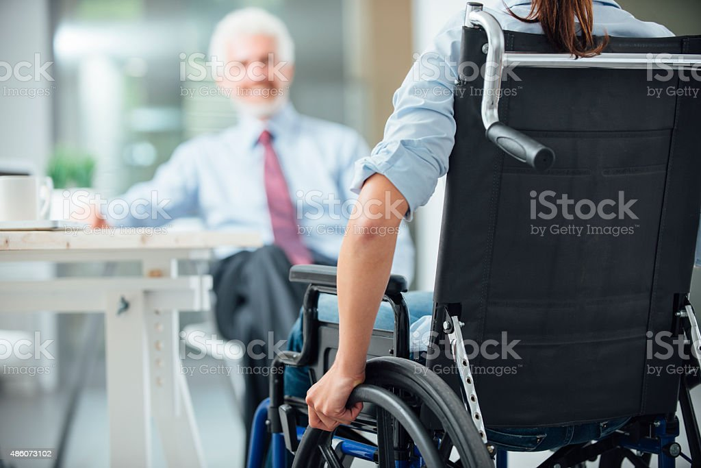 Disabled woman having a business meeting stock photo