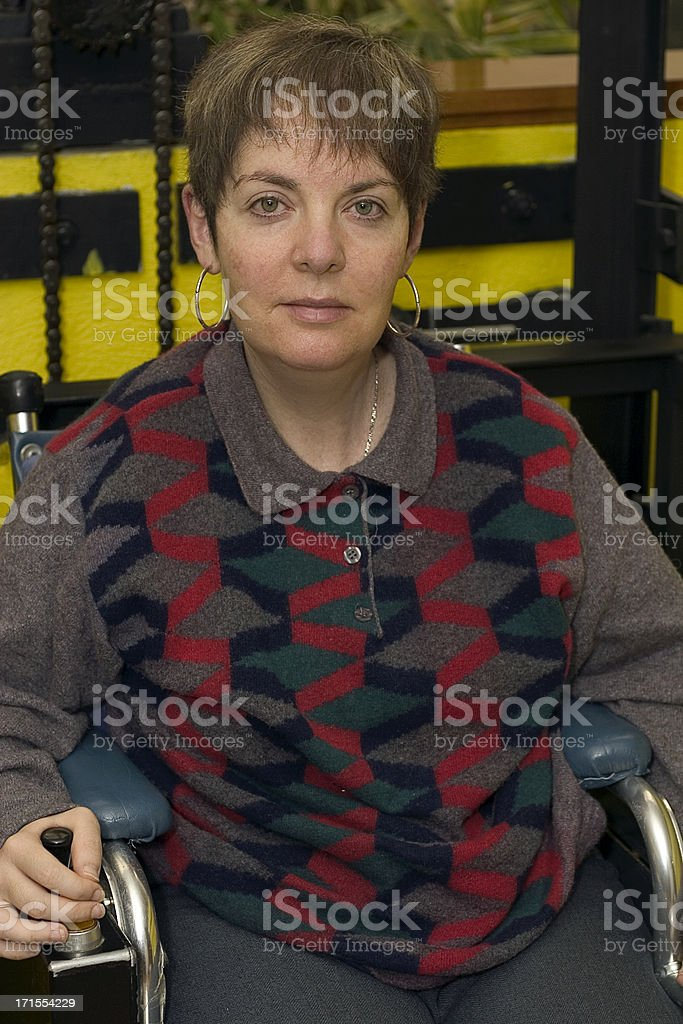 disabled woman in elevator royalty-free stock photo