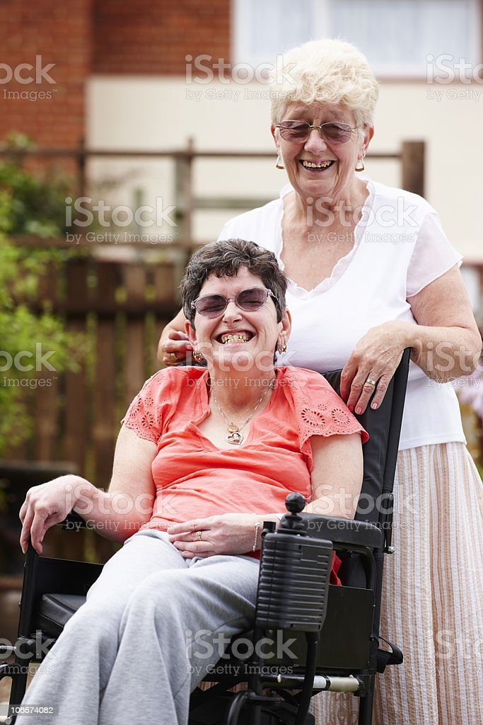 disabled woman with carer in garden stock photo