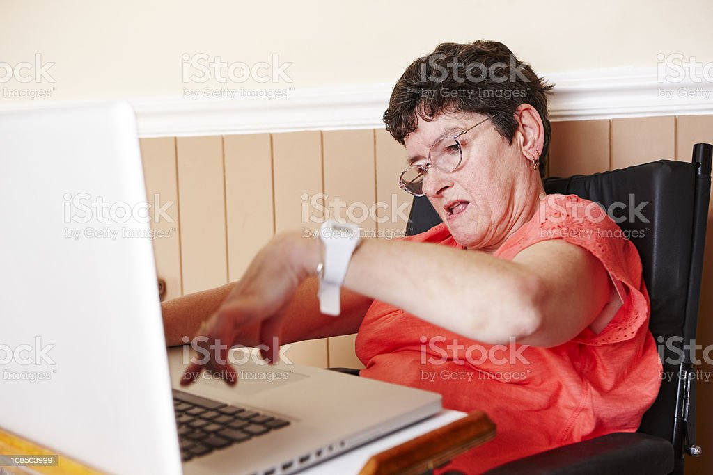 disabled woman working on laptop royalty-free stock photo