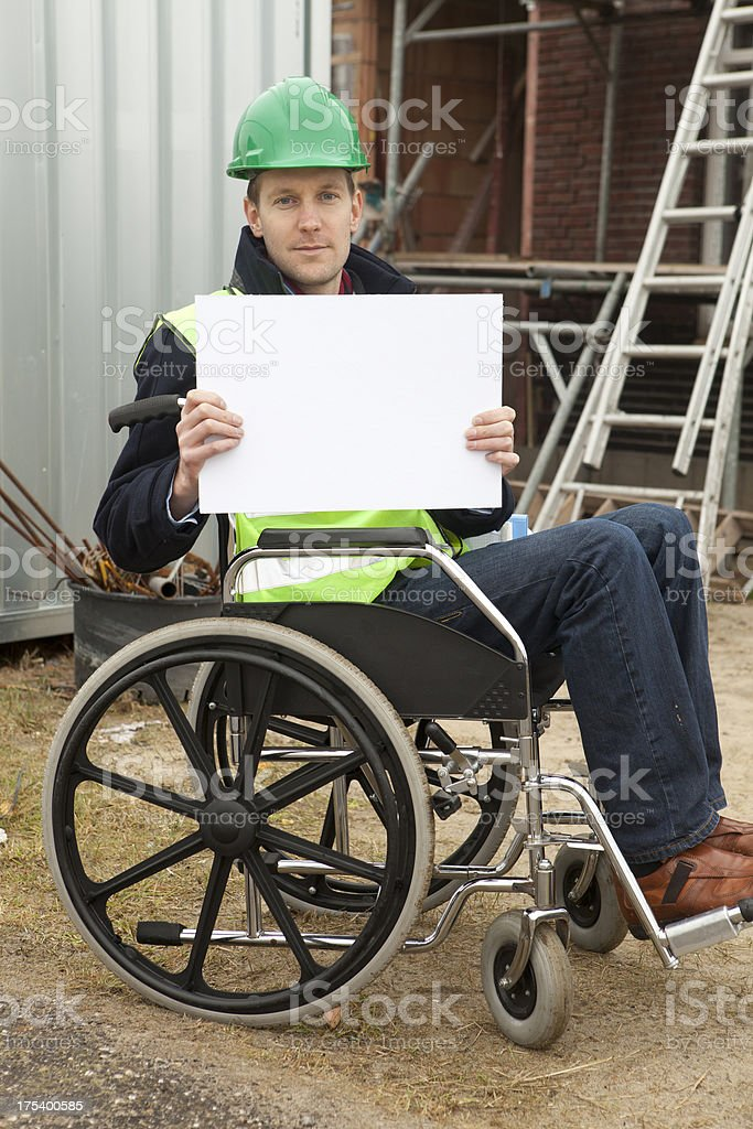 Disabled Worker Holding Blank Sign stock photo