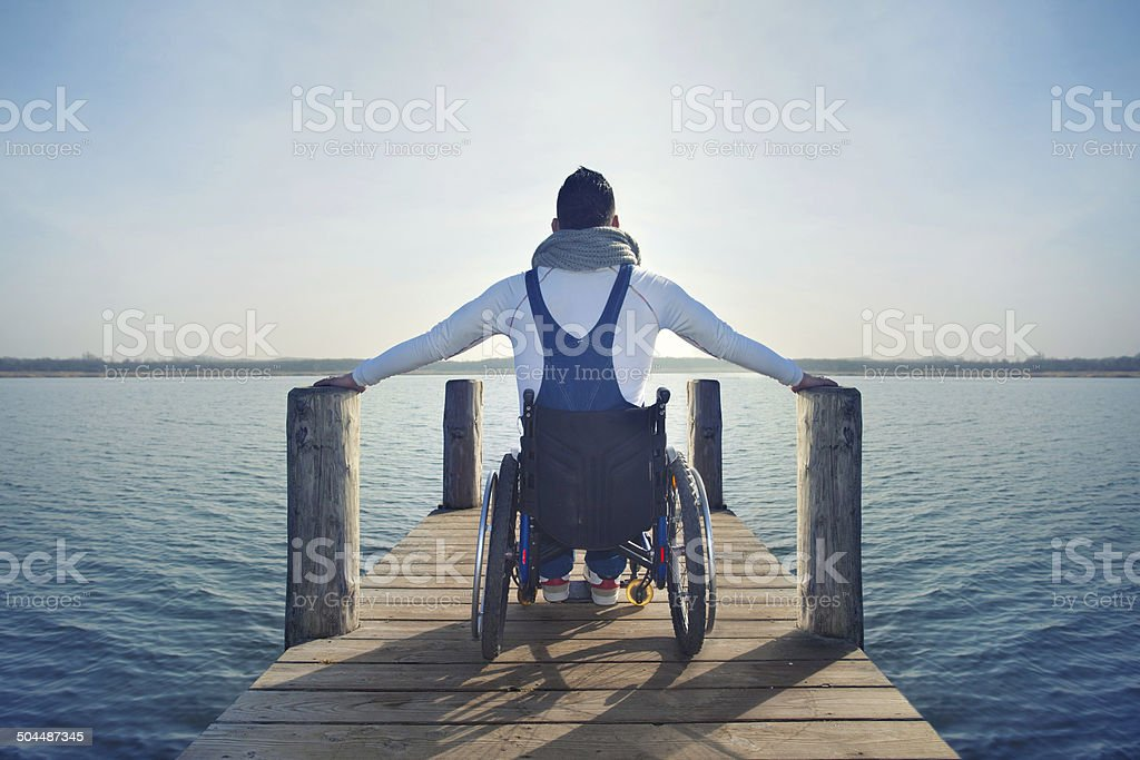 disabled Young man in wheelchair stock photo