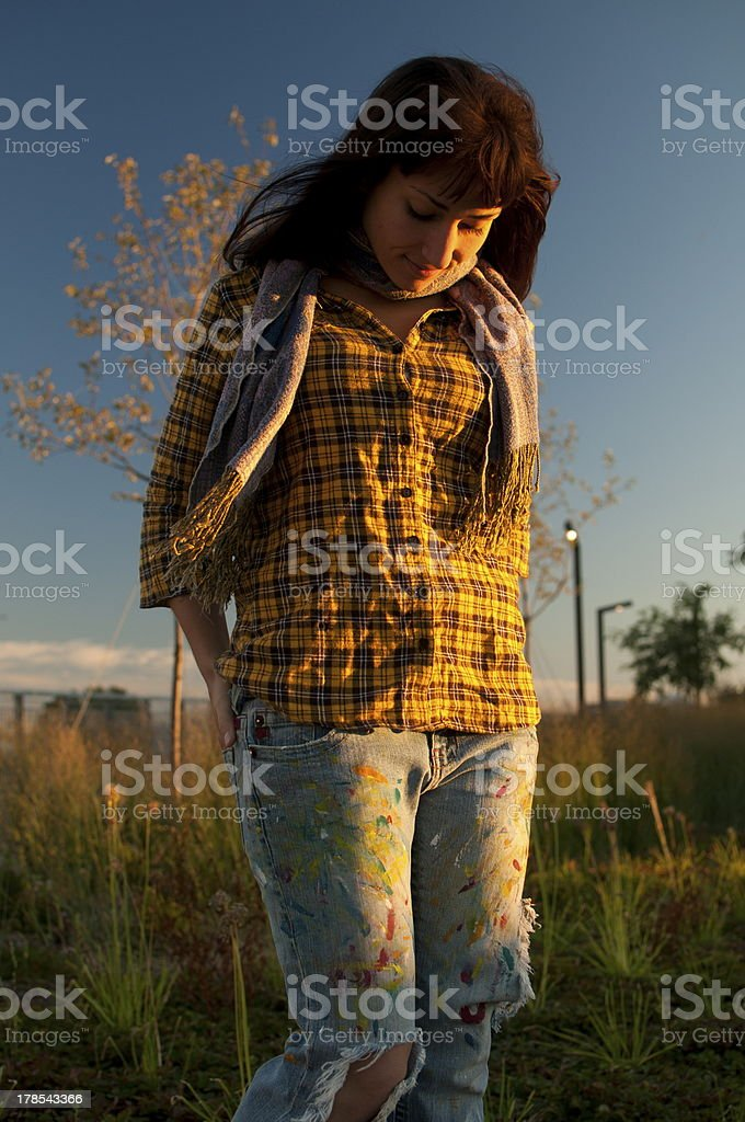 Disapointed student girl with yellow shirt jeans scarf in field royalty-free stock photo