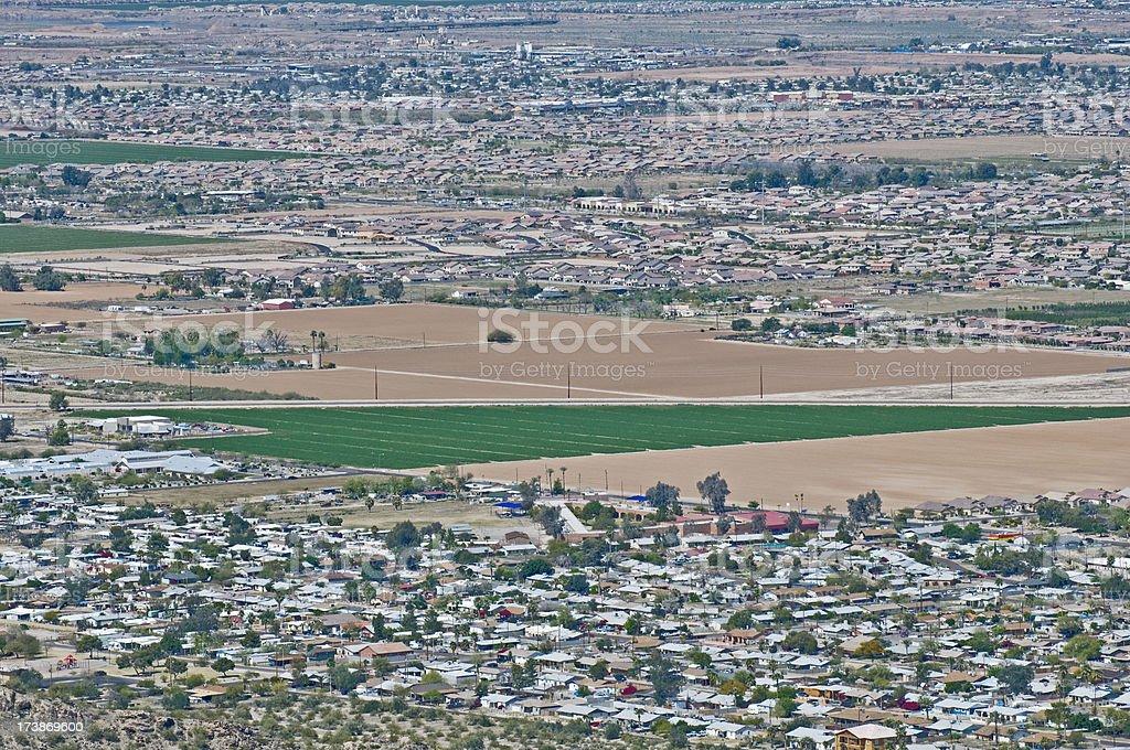 Disappearing farmland and housing developments in Arizona royalty-free stock photo