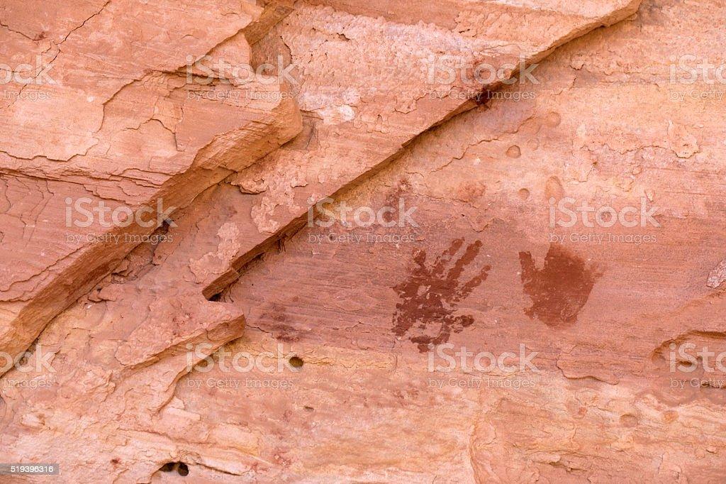 Disappearing hand print petroglyphs Cedar Mesa Pueblo ruins Utah stock photo