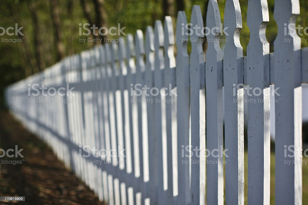 disappearing white picket fence royalty-free stock photo