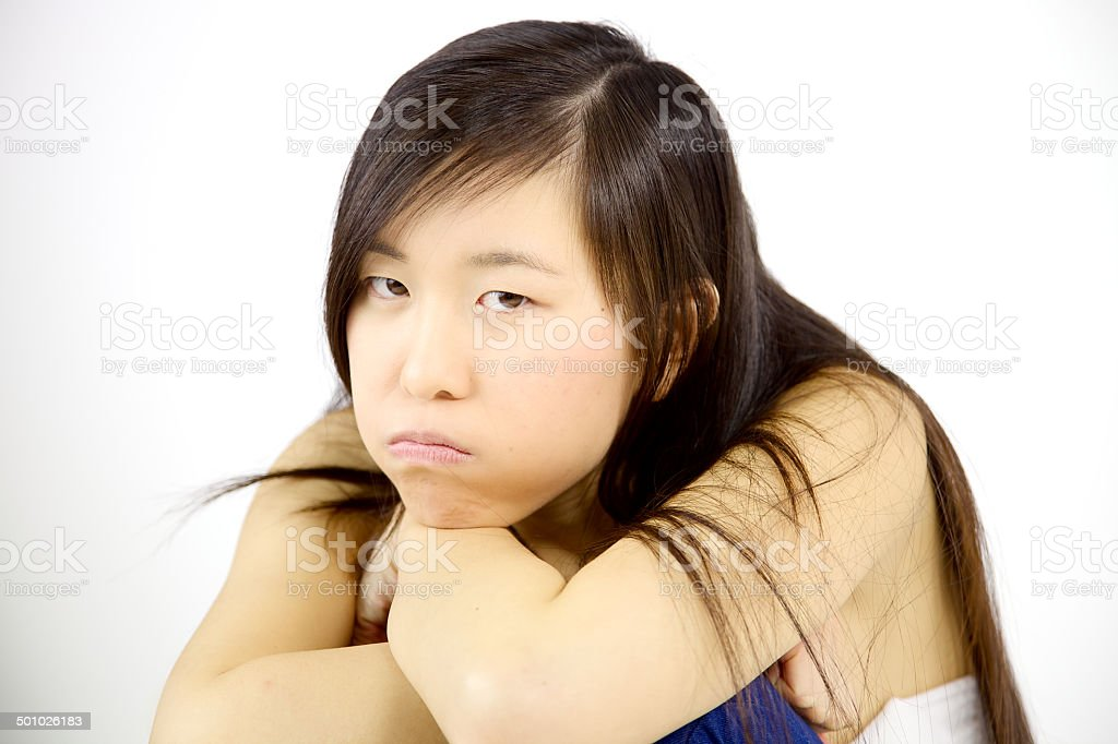 Disappointed asian girl looking angry royalty-free stock photo