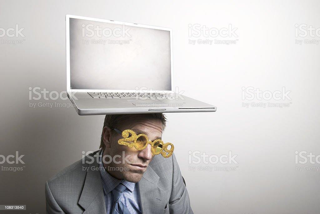 Disappointed Businessman Balances 2009 Laptop stock photo