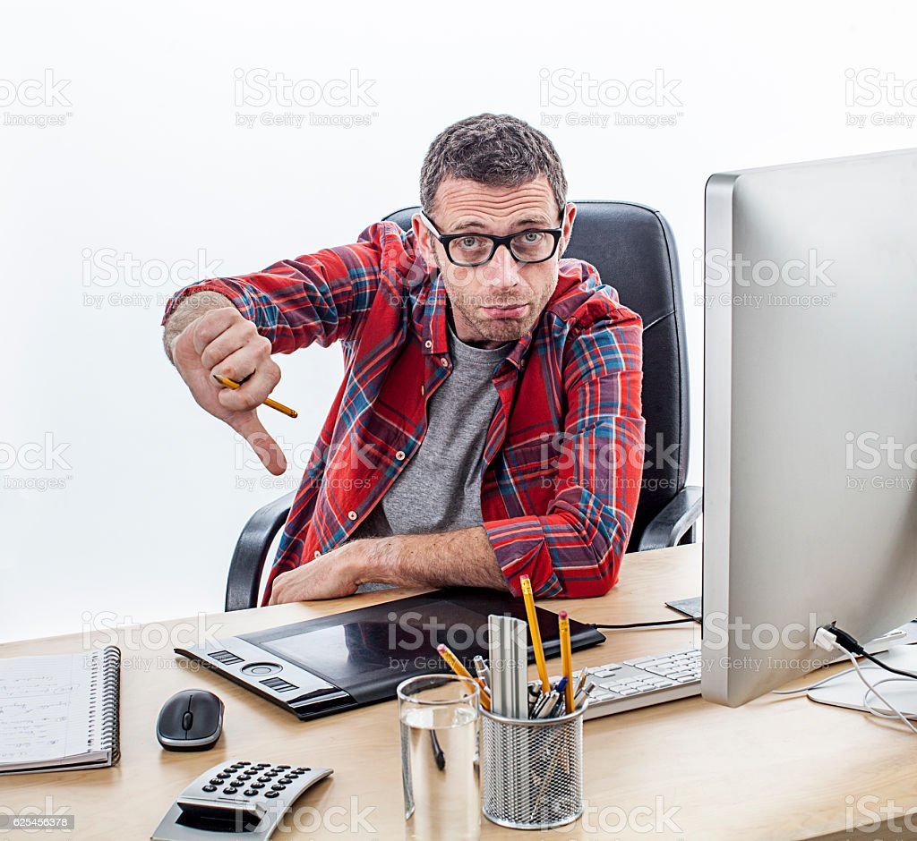 disappointed casual entrepreneur showing his disillusion with thumbs down stock photo