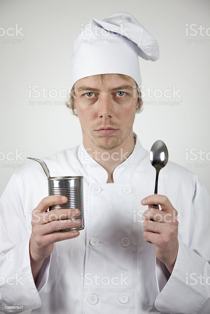 Disappointed Chef with Tinned Food stock photo