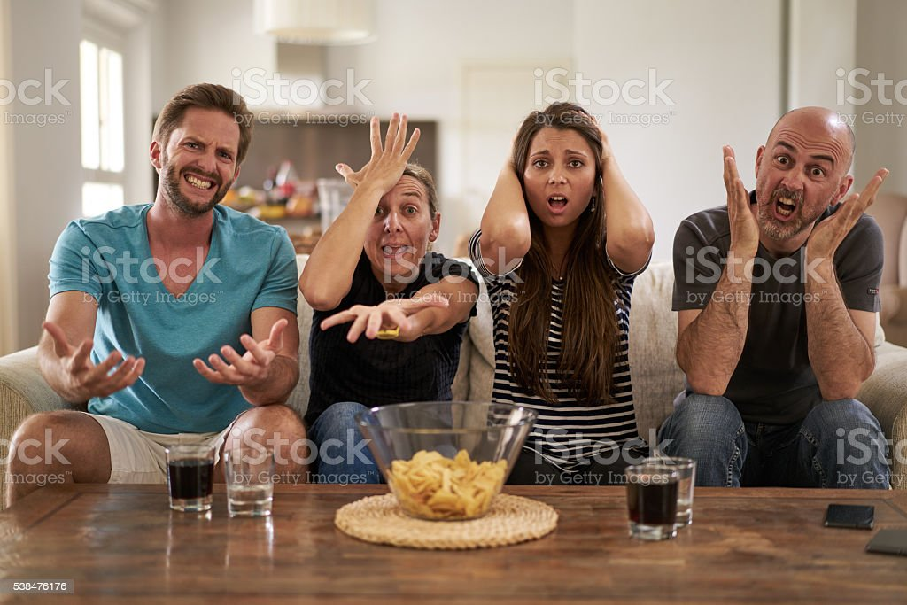 disappointed fans in front of tv stock photo