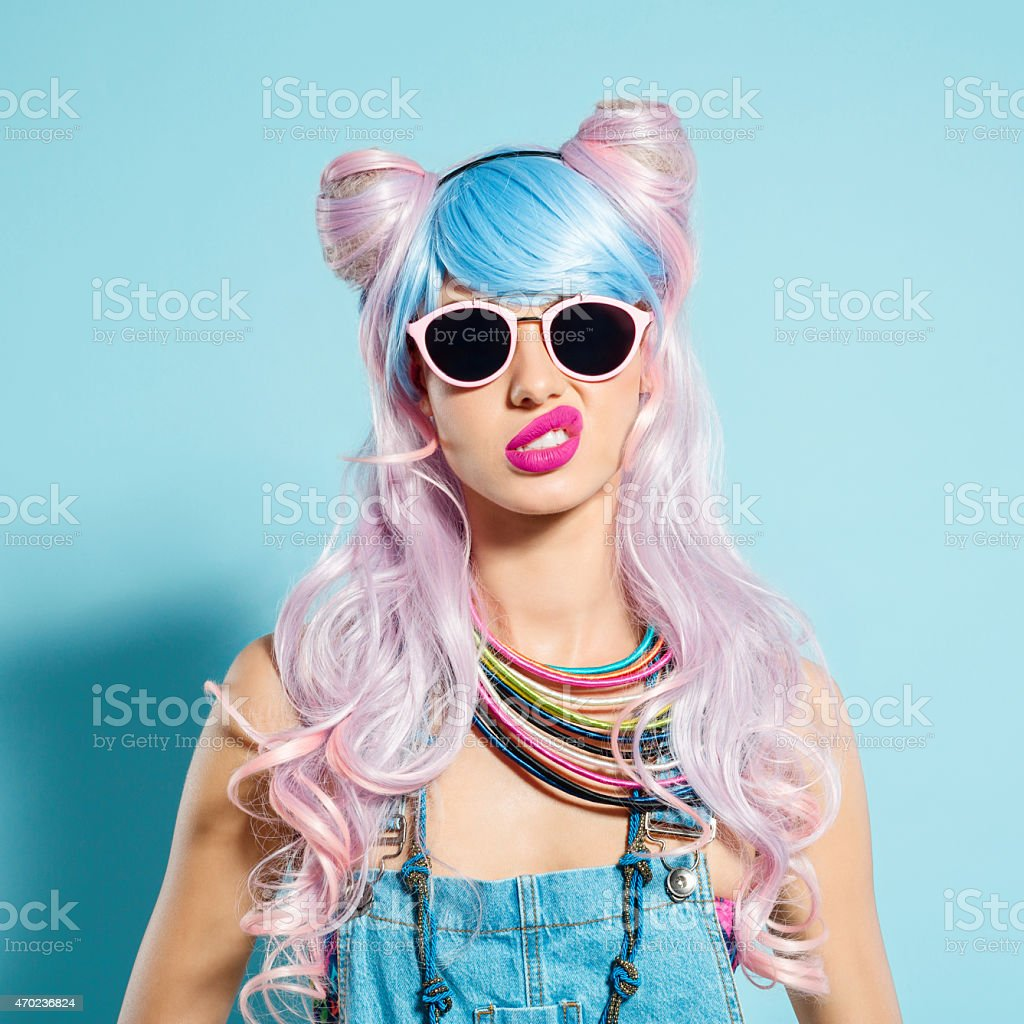 Disappointed pink hair girl in funky manga outfit stock photo