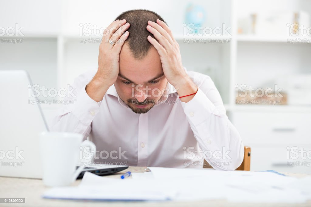 Disappointed worker feeling stressed stock photo