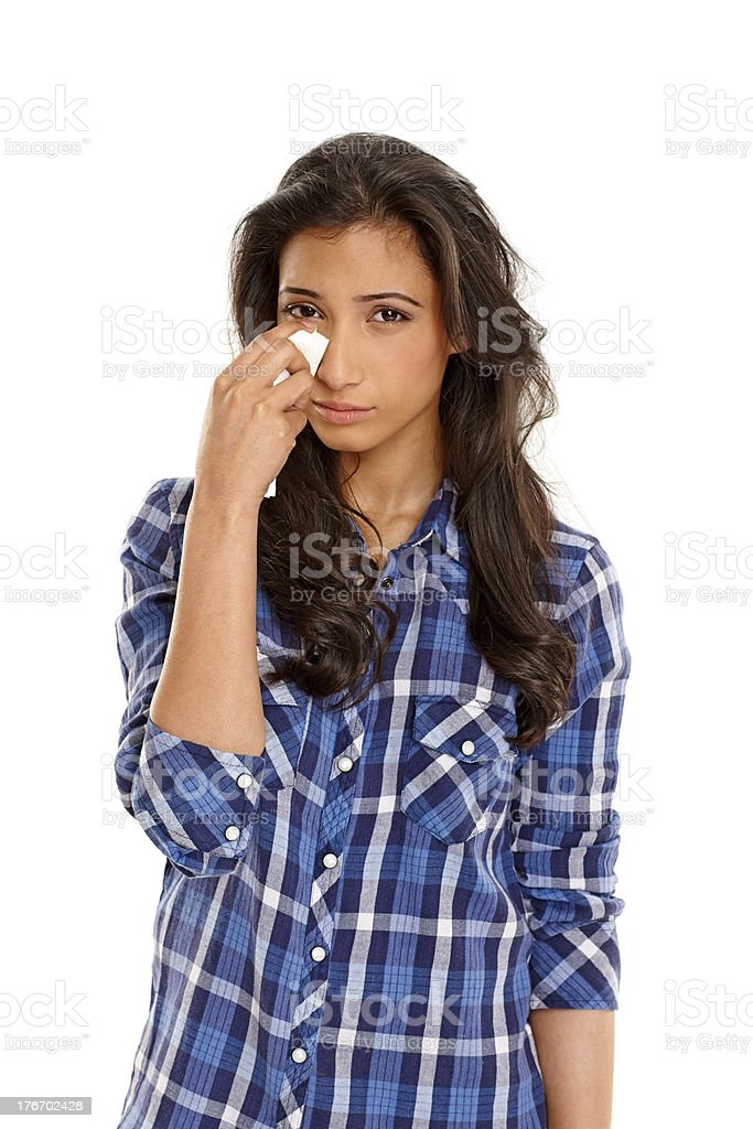 Disapponted young woman crying on white stock photo