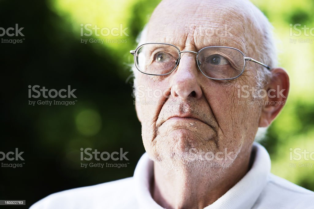 Disapproval, disbelief, stubbornness; this old man shows them all royalty-free stock photo