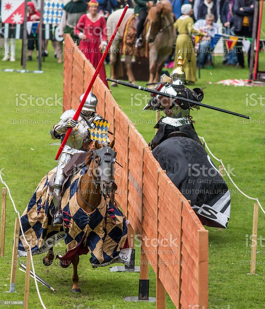 Disarmed - jousting knight loses lance stock photo