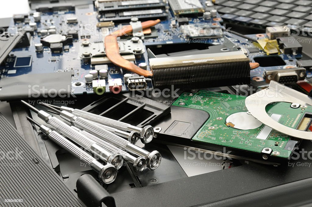 Disassemble the laptop and tools stock photo