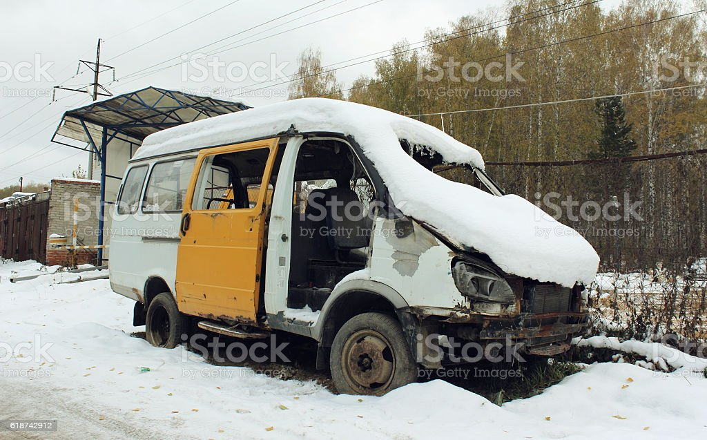 Disassembled car after the accident under the snow stock photo