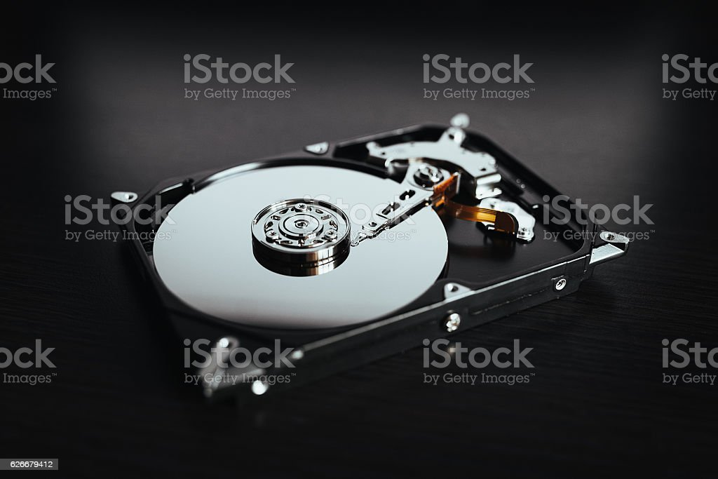 Disassembled hard drive from the computer, hdd with mirror effect. stock photo