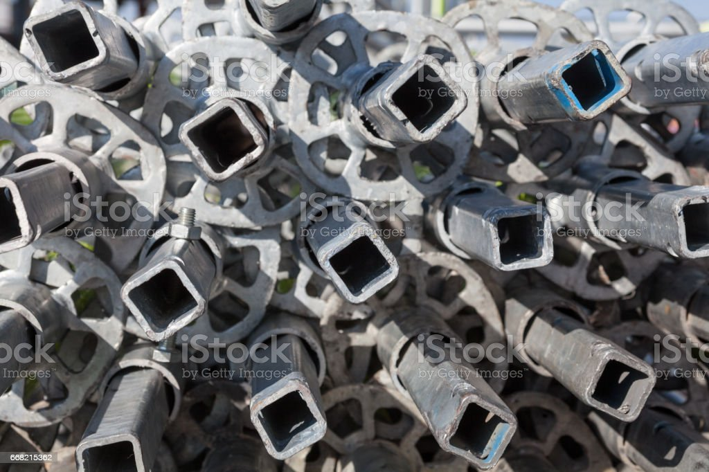 Disassembled metal scaffolding tubes stock photo
