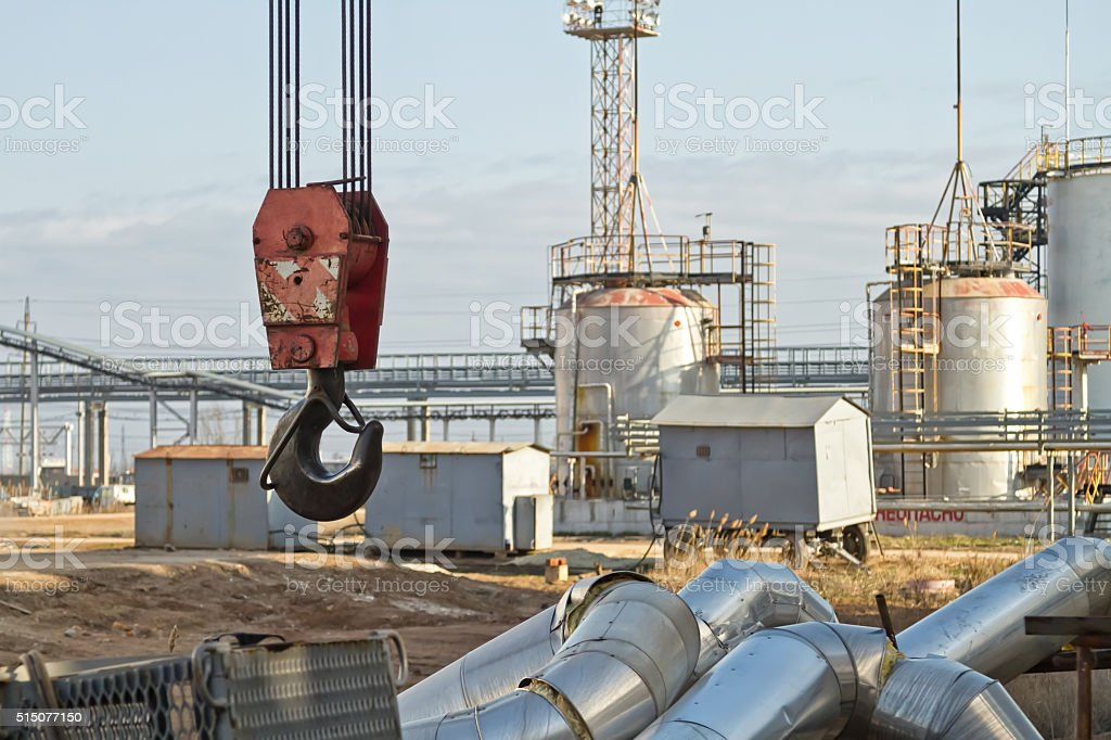 Disassembly of pipes by crane stock photo