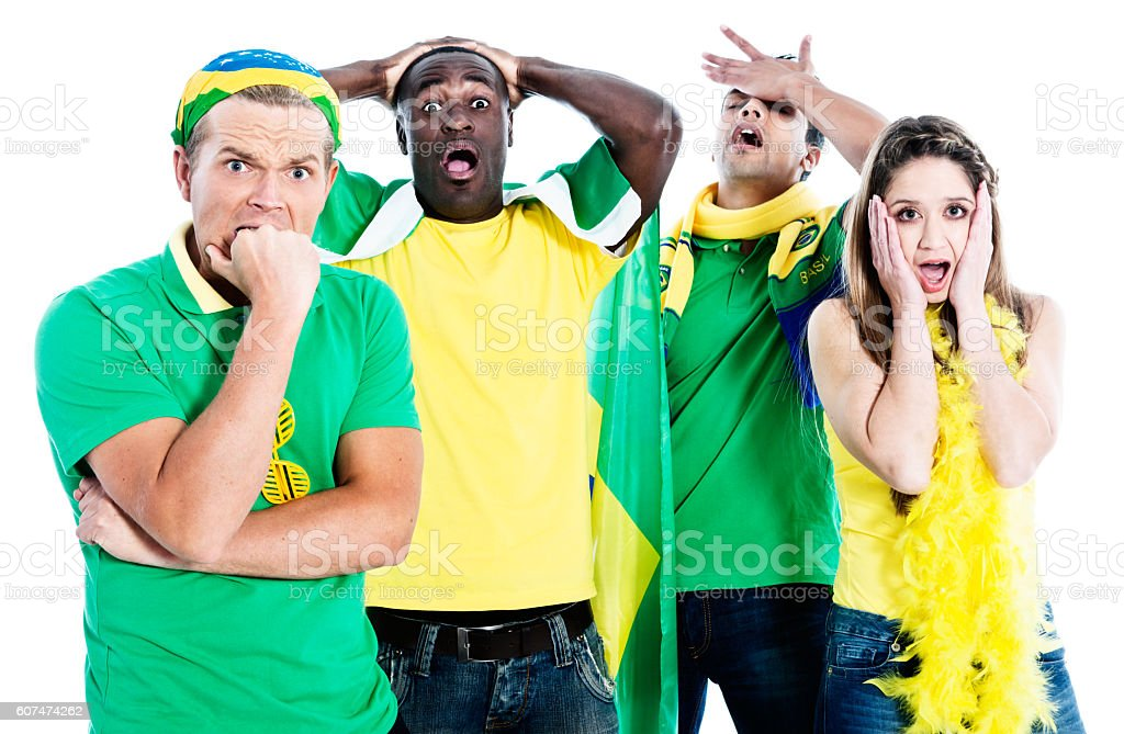 Disaster! Four sports fans devastated by team performance stock photo